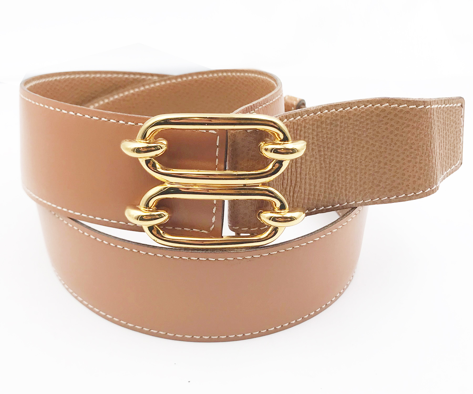 Our Rose Gold Plate Belt highlights the waist with a thick, wraparound plate of rose gold. Elasticized back and snap button closure. 35% Iron / 10% Polyurethane / 55% Elastic.